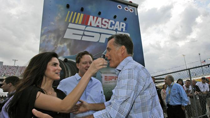 Republican presidential candidate Mitt Romney, right,greets NASCAR chairman Brian France, center rear, and his wife Amy France during a visit to the NASCAR Sprint Cup Series auto race at the Richmond International Raceway in Richmond, Va., Saturday, Sept. 8, 2012. (AP Photo/Steve Helber)