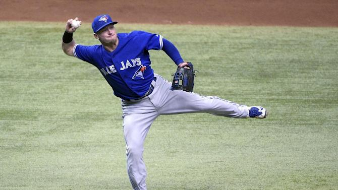Toronto Blue Jays third baseman Josh Donaldson throws to first base but can't get Tampa Bay Rays' Kevin Kiermaier in time after fielding his grounder during the sixth inning of a baseball game in St. Petersburg, Fla., Sunday, April 26, 2015.(AP Photo/Phelan M. Ebenhack)