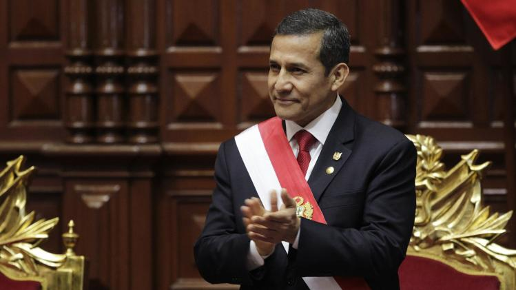 Peruvian President Ollanta Humala applauds before delivering a speech to the nation at the Congress on Independence Day, in Lima