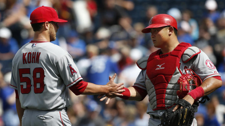 Los Angeles Angels relief pitcher Michael Kohn (58) is congratulated by catcher Hank Conger, right, following a baseball game against the Kansas City Royals at Kauffman Stadium in Kansas City, Mo., Saturday, May 25, 2013. The Angels defeated the Royals 7-0. (AP Photo/Orlin Wagner)