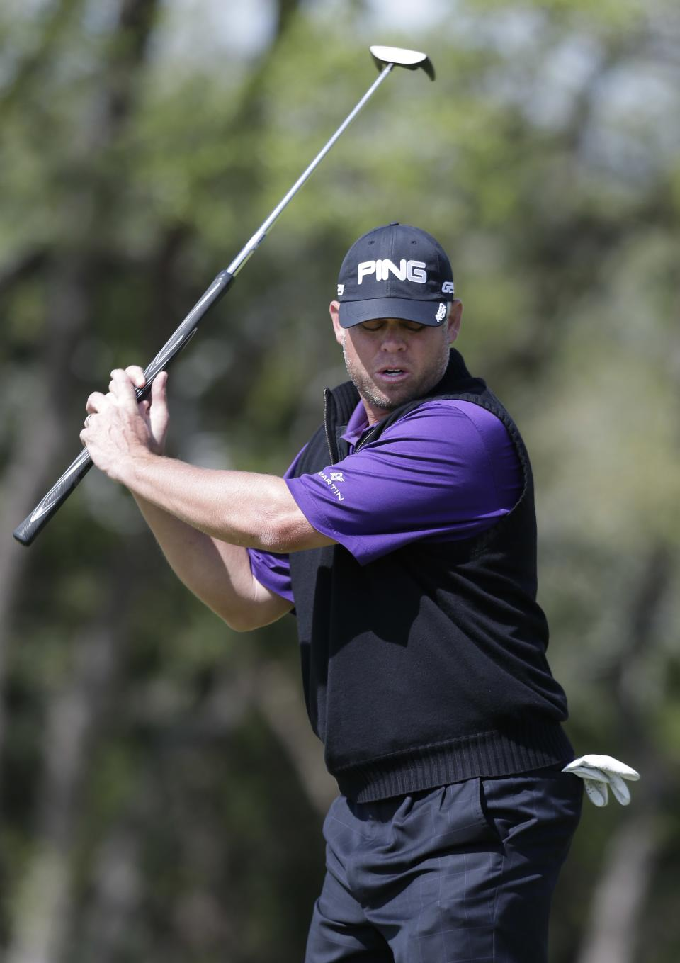 Joey Snyder III, of Scottsdale, Ariz., reacts to missing a birdie putt on the sixth hole during the second round of the Texas Open golf tournament, Friday, April 5, 2013, in San Antonio.  (AP Photo/Eric Gay)
