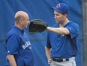 Toronto Blue Jays closer Casey Janssen, right, talks with Blue Jays lead trainer George Poulis, left, after throwing in the bullpen during baseball spring training in Dunedin, Fla., on Thursday, Feb. 14, 2013. THE CANADIAN PRESS/Nathan Denette