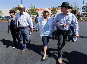Sisters of Cliven Bundy, Lillie Spencer(L) and Margaret Houston (R) walk with Bundy's sons Ammon and Ryan to file criminal complaints against the Bureau of Land Management at the Las Vegas Metropolitan Police Department in Las Vegas, Nevada