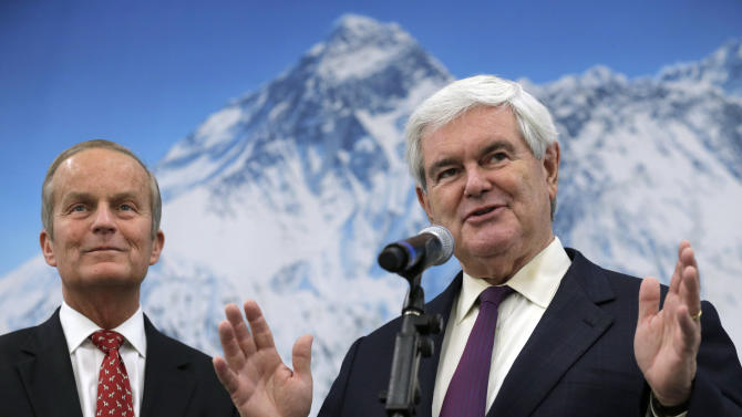 Missouri Senate candidate Rep. Todd Akin, R-Mo., left, listens while former Republican presidential hopeful Newt Gingrich speaks during a campaign stop at Bennett Packaging, Tuesday, Oct. 30, 2012, in Lee's Summit, Mo. Gingrich appeared with Akin at a pair of Kansas City-area fundraisers Tuesday as part of what Akin's campaign hopes will be a $1 million advertising push in the final week before the Nov. 6 election. (AP Photo/Charlie Riedel)