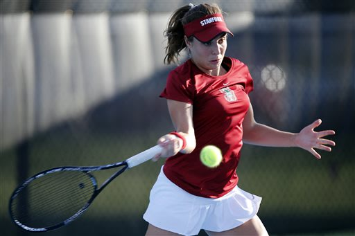 Stanford's Natalie Dillon returns a serve while playing in a doubles match with her partner, Krista Hardebeck, against Texas A&M's Ines Deheza and Paula Deheza at the NCAA division 1 women's team tenn