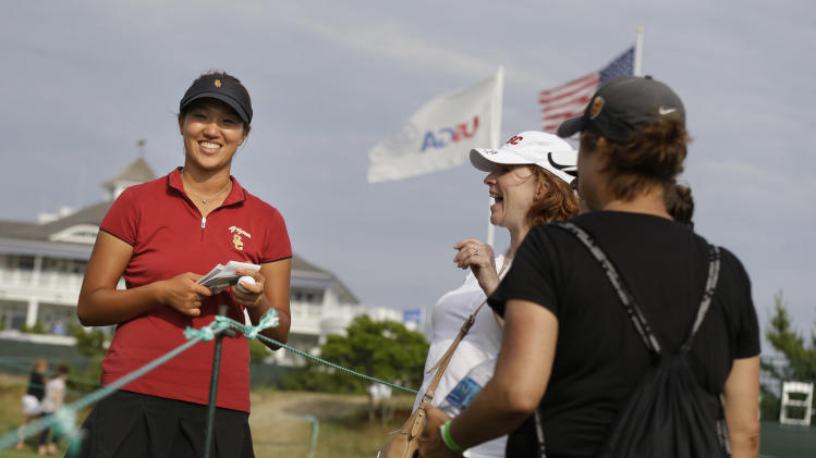 Annie Park talks to fans during a practice round for the U.S. Women's Open golf tournament at Sebonack Golf Club in Southampton, N.Y., Wednesday, June 26, 2013. (AP Photo/Seth Wenig)