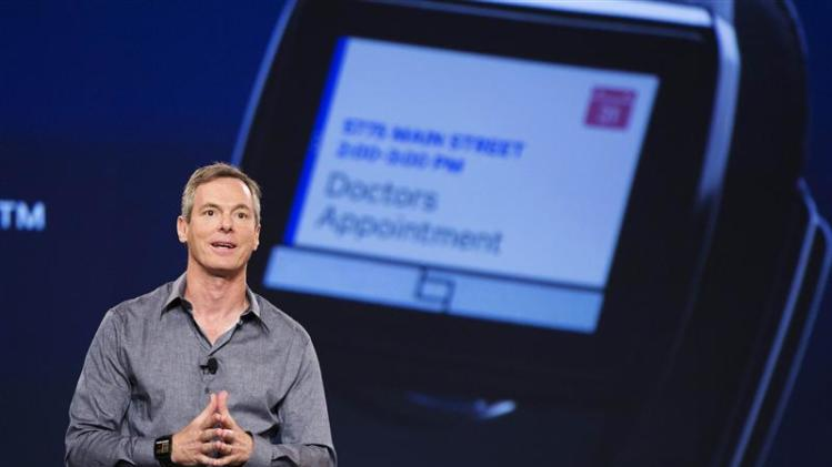 "Jacobs, chairman and CEO of Qualcomm, talks about the new ""Toq"" smartwatch at the Uplinq 2013 conference in San Diego"