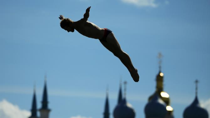 Jones of the U.S. jumps during the men's 27m High Diving competition preliminary at the Aquatics World Championships in Kazan