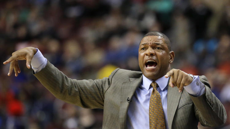 Boston Celtics head coach Doc Rivers yells to his team in the first half of an NBA basketball game against the Philadelphia 76ers, Friday, Dec. 7, 2012, in Philadelphia. (AP Photo/Matt Slocum)