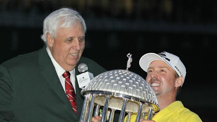 Jonas Blixt struggles to lift the trophy as Greenbrier resort owner Jim Justice, left, watches after Blixt won the Greenbrier Classic PGA golf tournament in White Sulphur Springs, W.Va., Sunday, July 7, 2013. (AP Photo/Steve Helber)