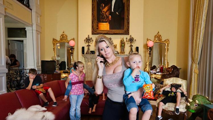 "This image released by Magnolia Pictures shows Jackie Siegel and her children from the documentary ""The Queen of Versailles."" (AP Photo/Magnolia Pictures, Lauren Greenfield)"
