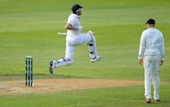 England&#39;s Nick Compton celebrates his maiden Test century, against New Zealand, in Dunedin, on March 9, 2013. Compton had a scare on 16 when New Zealand appealed for a catch down the leg-side but both the appeal and review were turned down