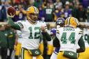 FILE - In this Sunday, Nov. 22, 2015. file photo, Green Bay Packers quarterback Aaron Rodgers (12) throws against the Minnesota Vikings during the first half of an NFL football game in Minneapolis. Packers quarterback Aaron Rodgers is looking forward to the return of predecessor Brett Favre on Thanksgiving night, Thursday, Nov. 26, 2015 at Lambeau Field. Favre's name and retired number will be unveiled on the north facade of the stadium at halftime of Green Bay's game against the Chicago Bears. (AP Photo/Ann Heisenfelt, File)