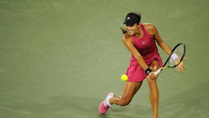 Ana Ivanovic of Serbia returns to Maria Sharapova of Russia during their match on August 16, 2014 in Cincinnati, Ohio