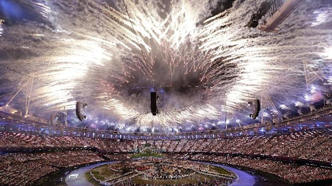 """FILE - In this Friday, July 27, 2012, file photo, fireworks explode during the Opening Ceremony at the 2012 Summer Olympics, in London. In Google's 12th annual roundup of global trending searches, """"Olympics 2012"""" was ranked at seventh. (AP Photo/Paul Sancya)"""
