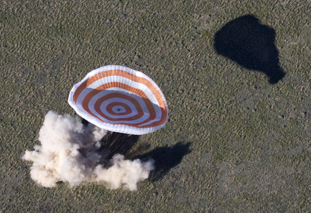 The Russian Soyuz space capsule, carrying U.S. astronaut Thomas Marshburn, Russian cosmonaut Roman Romanenko and Canadian astronaut Chris Hadfield, lands some 150 km (90 miles) southeast of the town o