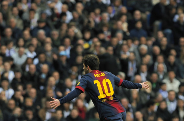 FC Barcelona's Lionel Messi from Argentina celebrates his goal during a Spanish La Liga soccer match against Real Madrid at the Santiago Bernabeu stadium in Madrid, Spain, Saturday, March 2, 2013. (AP