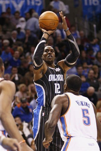 Durant helps Thunder beat Magic in opener