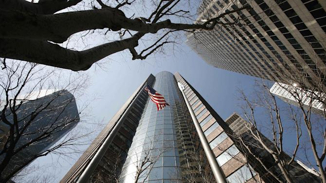 FILE - This March 17, 2009 file photo, shows an AIG office building in New York. American International Group Inc., reports quarterly financial results Thursday, Feb. 23, 2012, after the market close. (AP Photo/Mark Lennihan, File)
