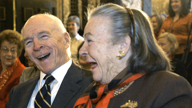 FILE - In this Dec. 6, 2007, file photo, philanthropist and political activist Elsie Hillman, right, and her billionaire industrialist husband Henry Hillman share a laugh during a Pittsburgh news conference about the Henry J. Hillman Foundation's $5.5 million donation to bolster the Pittsburgh Symphony Orchestra's international tours. Elsie Hillman's family announced that she died at her Pittsburgh home Tuesday, Aug. 4, 2015. She was 89. (AP Photo/Keith Srakocic, File)