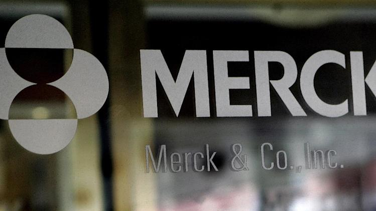 FILE - This May 22, 2008 file photo, shows the company logo on the doors of a building at Merck & Co. Inc. headquarters in Whitehouse Station, N.J. Drugmaker Merck & Co. has told employees it can't reach its goal of cutting up to 13,000 jobs by 2015 just by eliminating vacant jobs Tuesday, Sept. 20, 2011, so it is speeding up layoffs in the U.S. (AP Photo/Mel Evans, file)