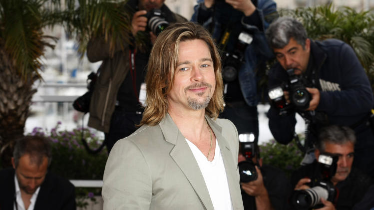 Actor Brad Pitt poses during a photo call for Killing Them Softly at the 65th international film festival, in Cannes, southern France, Tuesday, May 22, 2012. (AP Photo/Lionel Cironneau)