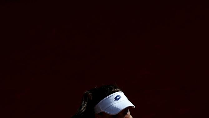 Radwanska of Poland returns the ball to Dellacqua of Australia during their match at the Madrid Open tennis tournament in Madrid