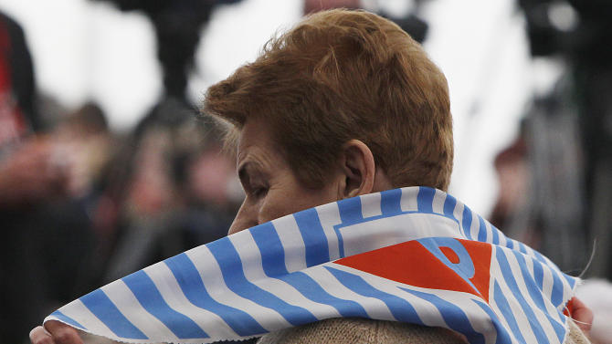 A former prisoner  attends a ceremony at  the Auschwitz concentration camp  in Oswiecim, Poland, Sunday, Jan. 27, 2013,  marking the 68th anniversary of the liberation of Auschwitz by Soviet troops and  remembering  the victims of the Holocaust, in Auschwitz-Birkenau.  (AP Photo/Czarek Sokolowski)