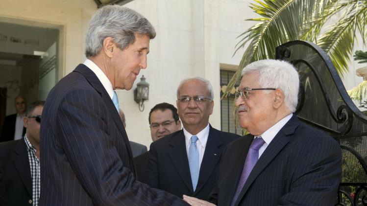 U.S. Secretary of State John Kerry, left, says goodbye to Palestinian President Mahmoud Abbas after their second meeting in Amman, Jordan on Saturday, June 29, 2013. On his fifth trip to the Middle East, Kerry held talks with Abbas on Saturday for the second time in two days, continuing his rushed round of shuttle diplomacy to restart talks between Israel and the Palestinians. At center is Saeb Erekat, Palestinian chief negotiator. (AP Photo/Jacquelyn Martin, Pool)
