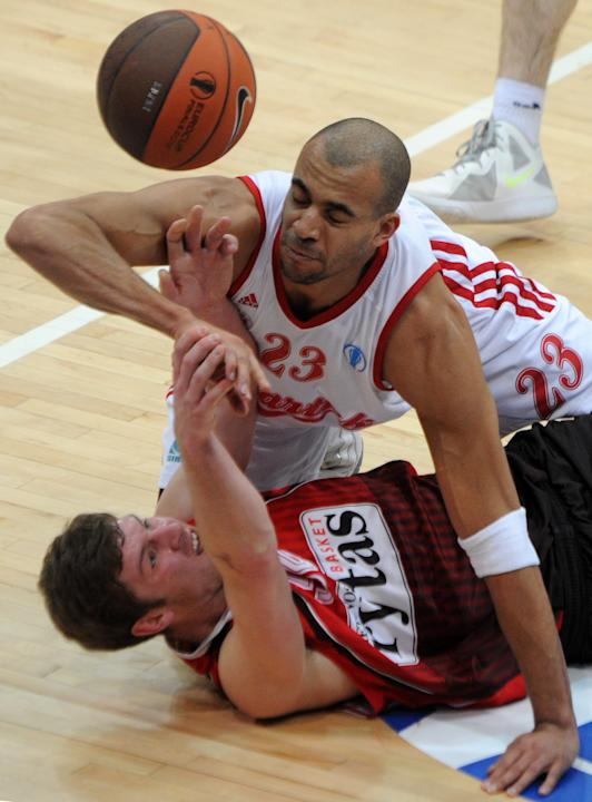 Lietuvos Rytas' Dovydas Redikas vies with BC Spartak Saint-Petersburg's Victor Keyru (top) during Eurocup's Final Four third place basketball match between Lietuvos Rytas and BC Spartak Saint-Petersbu