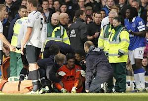 Tottenham Hotspur's goalkeeper Lloris is attended to by medical staff after being involved in a collision with Everton's Lukaku during their English Premier League soccer match at Goodison Park in Liverpool