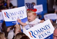 A child waves at a campaign rally for US Republican presidential candidate Mitt Romney at the Wings Over the Rockies Air and Space Museum in Denver, Colorado, on October 1. Romney said he was eager to go up against President Barack Obama in their three debates, beginning with Wednesday's looming debut showdown in the political battleground of Colorado