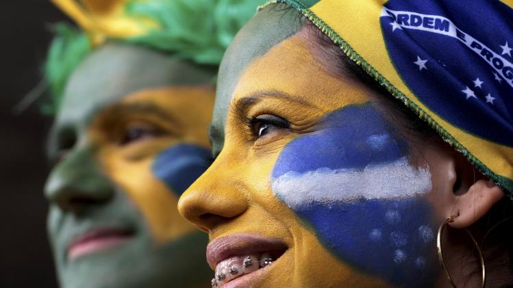 Brazil fans show their support before the 2014 World Cup Group A soccer match between Cameroon and Brazil at the Brasilia national stadium in Brasilia
