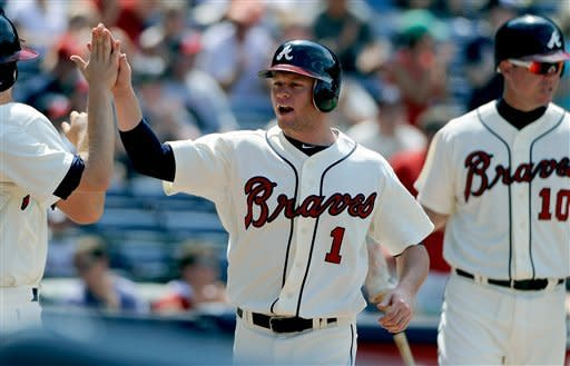 Braves complete sweep, beat Halladay, Phillies 6-2