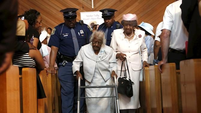 Talley is escorted down the aisle following a church service and celebration for her 116th birthday in Inkster
