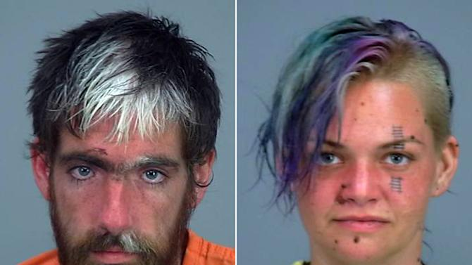 This combination made from photos provided by the Pinal County Sheriff's office shows Nathan Lamb, 25, left, and his girlfriend, Elizabeth Kay, 25, both of Phoenix. An Arizona sheriff's office says it will ask for murder charges against the couple after a man with heat exhaustion died after being found in a truck with other immigrants. Lamb was the driver of the truck, and Kay the passenger. (AP Photo/Pinal County Sheriff's Office)