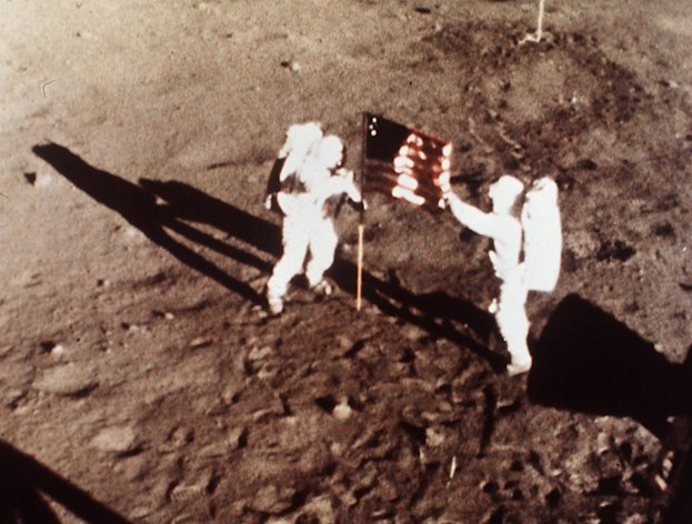 "FILE - In this July 20, 1969 file photo provided by NASA shows Apollo 11 astronauts Neil Armstrong and Edwin E. ""Buzz"" Aldrin, the first men to land on the moon, plant the U.S. flag on the lunar surface. The family of Neil Armstrong, the first man to walk on the moon, says he has died at age 82. A statement from the family says he died following complications resulting from cardiovascular procedures. It doesn't say where he died. Armstrong commanded the Apollo 11 spacecraft that landed on the moon July 20, 1969. He radioed back to Earth the historic news of ""one giant leap for mankind."" Armstrong and fellow astronaut Edwin ""Buzz"" Aldrin spent nearly three hours walking on the moon, collecting samples, conducting experiments and taking photographs. In all, 12 Americans walked on the moon from 1969 to 1972. (AP Photo/NASA)"