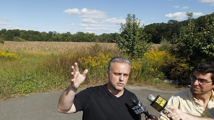 West Windsor police Lt. Robert Garofolo answers a question as he stands near a cornfild where a helicopter crashed Saturday, Sept. 15, 2012, in West Windsor, N.J. Garofolo said that police received witness reports that the helicopter struck a flock of birds shortly before crashing in a corn field. (AP Photo/Mel Evans)