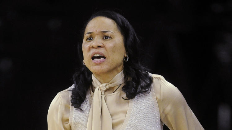 FILE - In this March 7, 2013, file photo, South Carolina head coach Dawn Staley talks to her players during the second half in an NCAA college basketball game against Alabama in the Southeastern Conference tournament in Duluth, Ga. (AP Photo/John Amis, File)