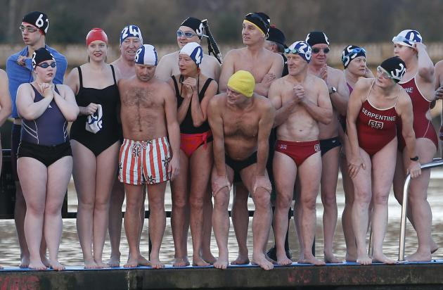 Swimmers wait to dive into the Serpentine river on Christmas Day in Hyde Park, central London