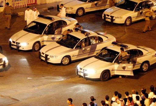 Saudi police cars in the port city of Jeddah. Saudi police and members of the feared religious police are responsible for the death of a man and the injury of his pregnant wife and two children in a car chase, said an inquiry published on Wednesday