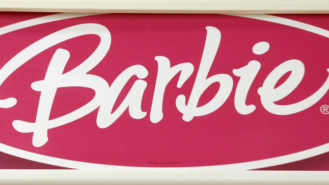 In this Monday, July 16, 2012 photo, the Barbie logo is displayed at a local toy store in Hialeah, Fla. Demand for doll brands including Barbie, American Girl and Monster High, coupled with lower sales costs and advertising expenses, helped the biggest U.S. toy maker's net income rise 20 percent in the second quarter. Mattel, which also makes Hot Wheels and Fisher-Price toys, said Tuesday, July 17, 2012,  that its net income rose to $96.2 million, or 28 cents per share, in the April to June quarter. (AP Photo/Alan Diaz)