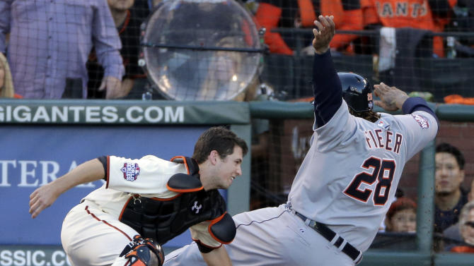 San Francisco Giants' Buster Posey tags out Detroit Tigers' Prince Fielder, right, at home plate in the second inning of Game 2 of baseball's World Series Thursday, Oct. 25, 2012, in San Francisco. (AP Photo/Charlie Riedel)