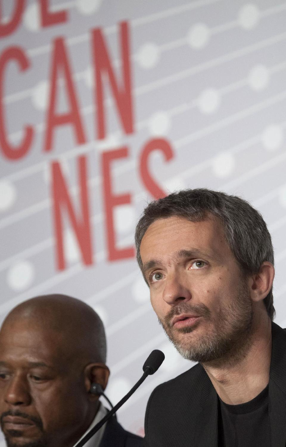 Director Jerome Salle speaks during a press conference for the film Zulu at the 66th international film festival, in Cannes, southern France, Sunday, May 26, 2013. (AP Photo/Virginia Mayo)