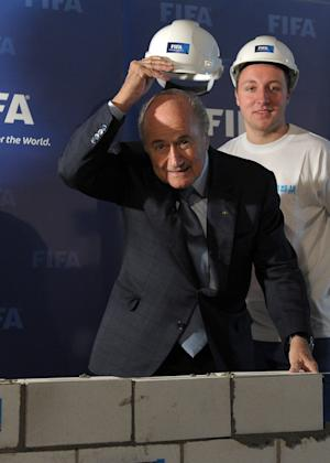FIFA President Joseph S. Blatter, left, symbolically launches the construction work for the new FIFA museum in Zurich, Switzerland, Thursday, April 25, 2013. FIFA says its US dollar 200 million museum will now be created downtown in its home city of Zurich. Construction work has started in the Enge district and the museum is scheduled to open in April or May 2015. (AP Photo/Keystone, Steffen Schmidt)