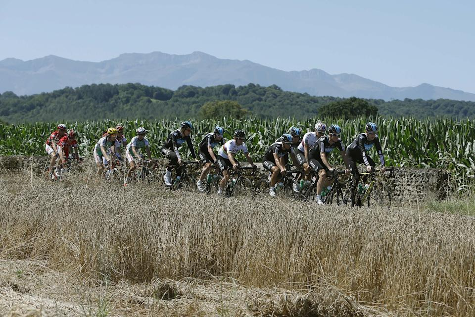 Team Sky with overall leader Bradley Wiggins of Britain, front right, trains on the rest day of the Tour de France cycling race near Pau, France, as Pyrenees mountains are seen in the background Tuesday July 17, 2012. (AP Photo/Laurent Cipriani)