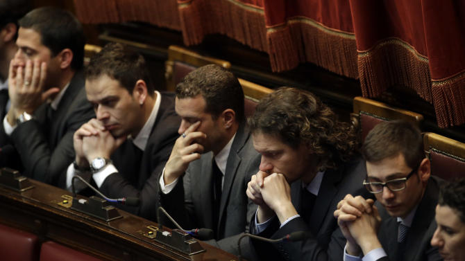 Five star movement party lawmakers attend the first parliament session to elect the lower chamber president in Rome, Friday, March 15, 2013.  Italy's newly elected Parliament was heading toward political gridlock as it meets for the first time after inconclusive elections gave no party a clear victory. Investors will keep a close eye on the inaugural session Friday when both chambers will vote for leaders. Only then can Italy's president open talks on forming a government, expected next week. (AP Photo/Gregorio Borgia)
