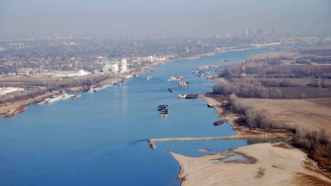 FILE - This Nov. 28, 2012 file photo provided by The United States Coast Guard shows man-made dikes, perpendicular to the shore, that direct the water flow back into the river to maintain a navigable depth along on the Mississippi River South of St. Louis. The National Weather Service revised the Mississippi River forecast Wednesday, Dec. 5, 2012, offering a bit of a reprieve for shippers, showing the water level isn't dropping as quickly as feared. Still, at least two large barge companies already are reducing loads over concerns about the river's depth. (AP Photo/United States Coast Guard, Colby Buchanan, File)