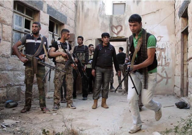Free Syrian Army fighters prepare to raid a house in Daraa