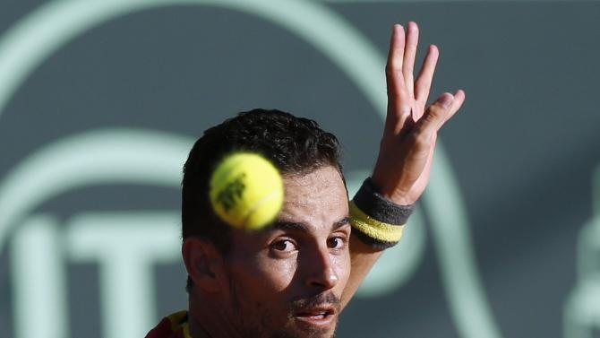 Colombia's Santiago Giraldo eyes the ball before returning it to Uruguay's Martin Cuevas during their Davis Cup tennis match in Montevideo